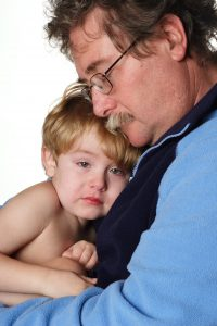 comfort_man-with-child_dreamstime_xxl_1858887
